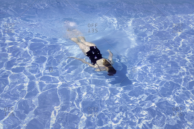 Woman swimming in swimming-pool
