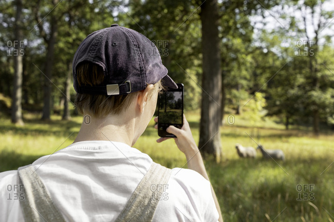 Man photographing with cell phone