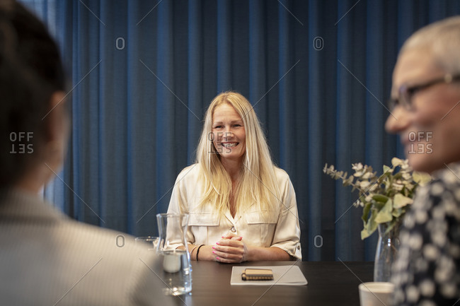 Smiling woman at business meeting