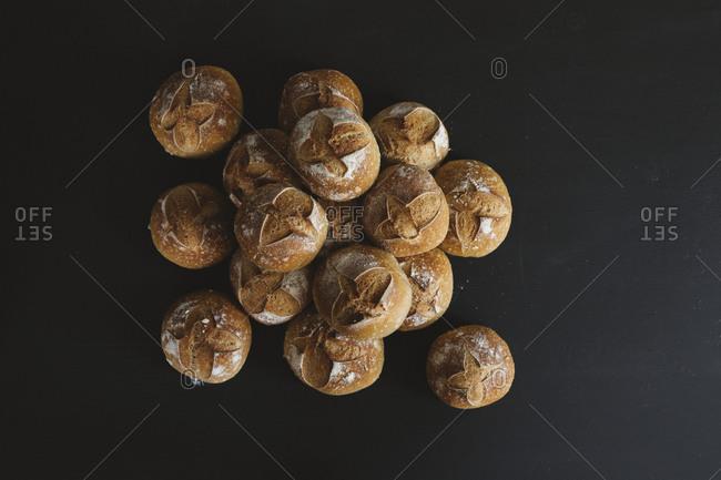Bread rolls on black background