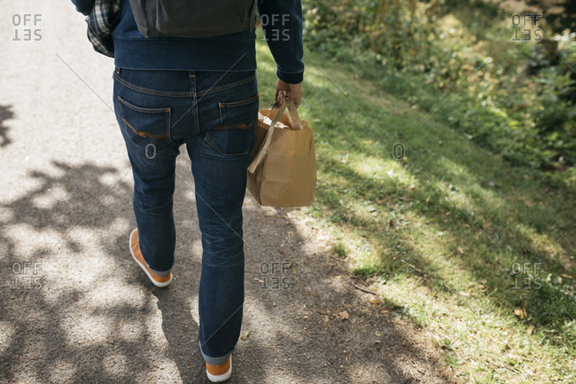 Man carrying paper bag