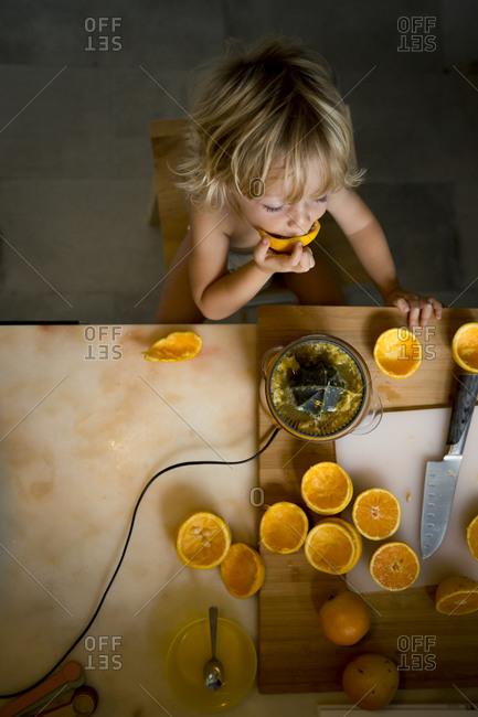 Boy eating oranges