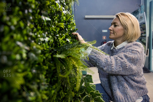 Woman taking care of indoor plants
