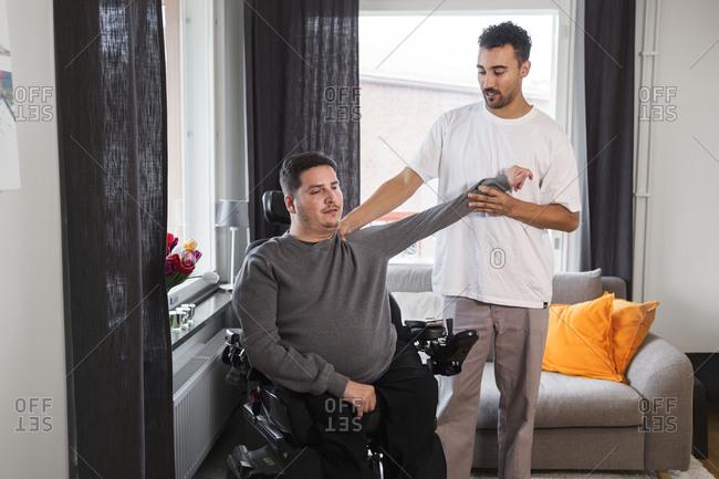 Career helping man in wheelchair