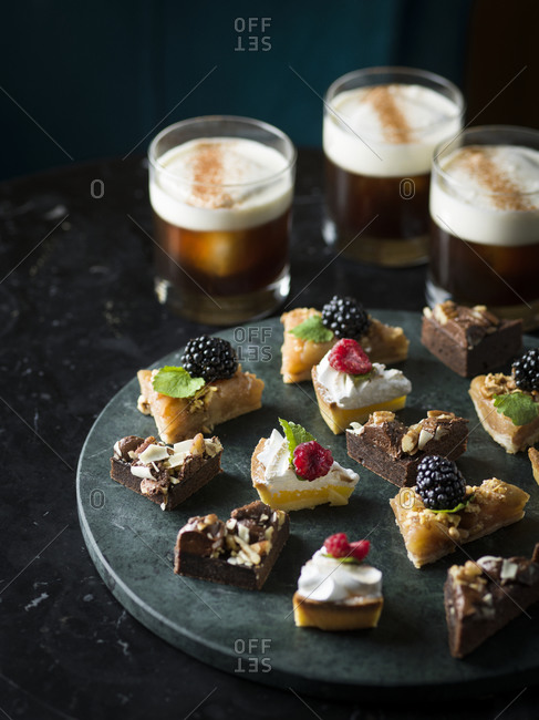 Sweet dessert with drinks on background