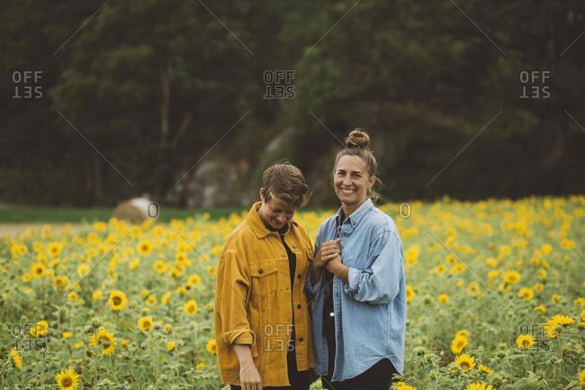 Couple on flowering sunflower field