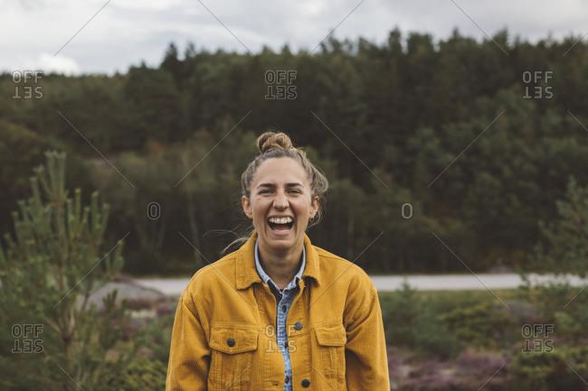 Happy woman looking at camera