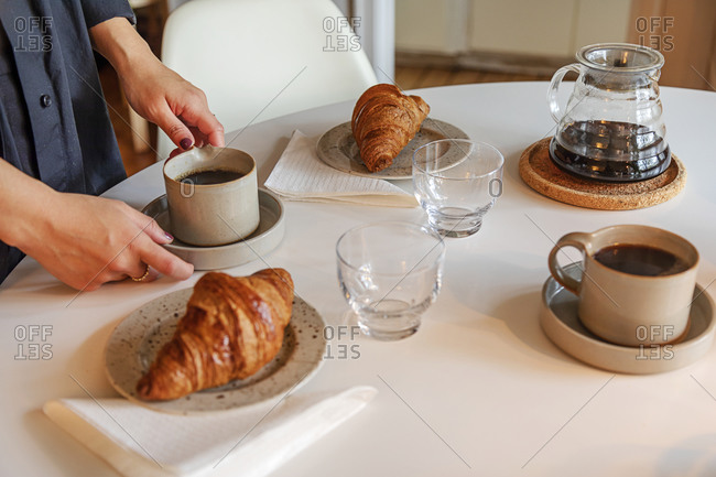 Coffee cups and croissants