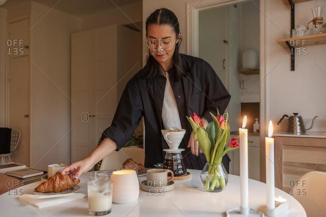 Woman preparing coffee