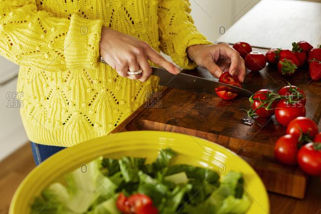 Woman cutting tomatoes