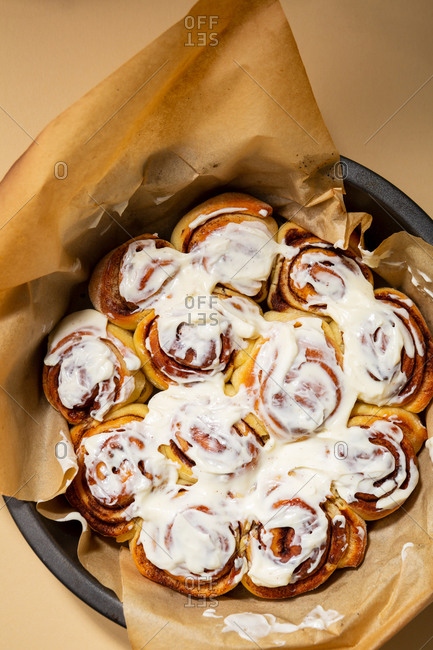 Overhead view of cinnamon bun drizzled with vanilla icing