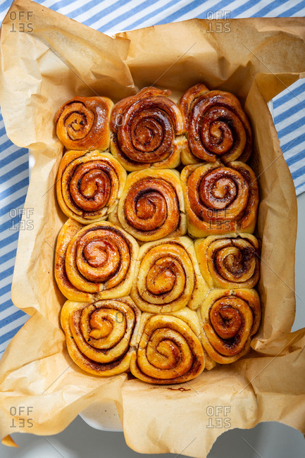 Overhead view of cinnamon bun drizzled with syrup