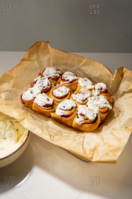 High angle view of cinnamon buns topped with icing