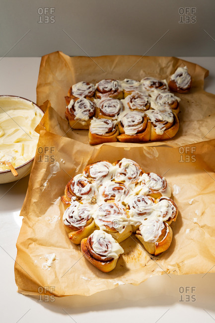 Cinnamon buns topped with frosting