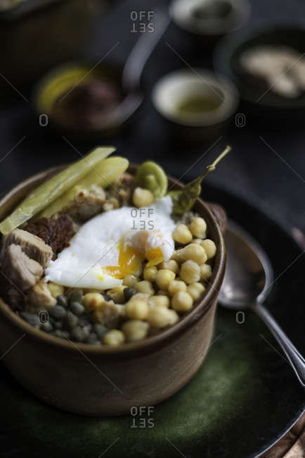 A Tunisian chickpeas dish prepared with tuna and a poached egg