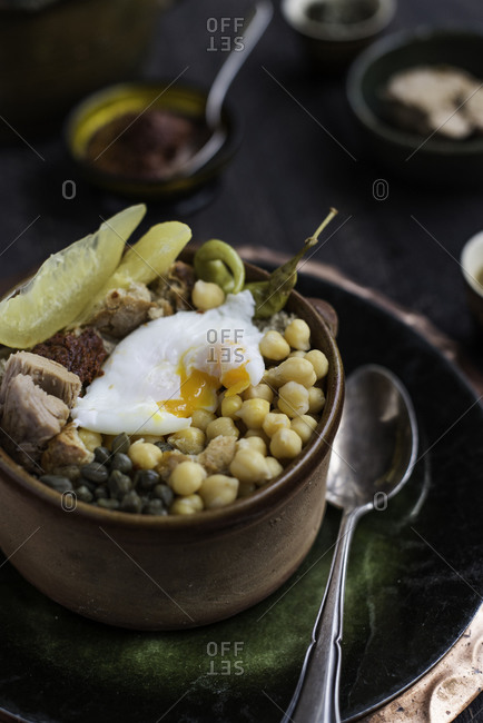 A Tunisian chickpeas dish prepared with tuna, poached egg, and spices