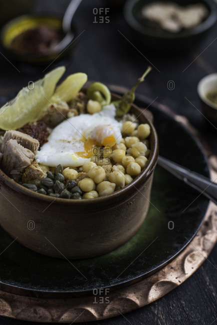 A Tunisian chickpeas dish prepared with tuna and a poached egg, ready to eat
