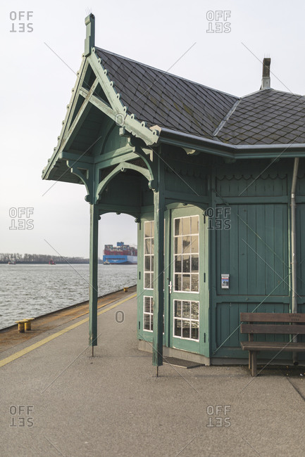 Germany- Hamburg- Green old-fashioned kiosk standing at edge of harbor