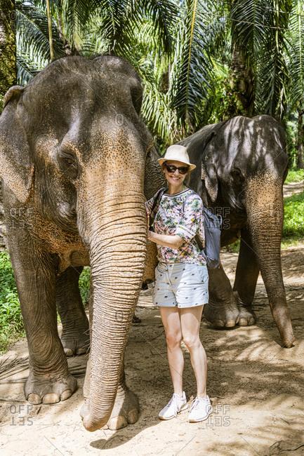 Portrait of smiling woman with elephants in sanctuary- Krabi- Thailand