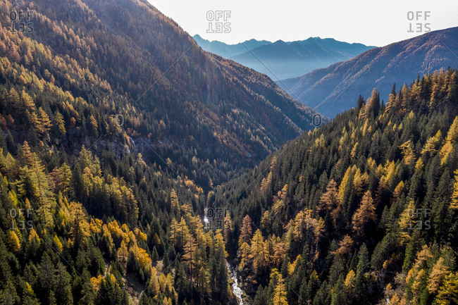 Austria- Carinthia- Aerial view of forested mountain valley in autumn