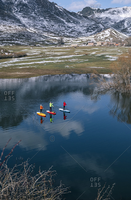 Aerial view of three people stand up paddle surfing- Leon- Spain
