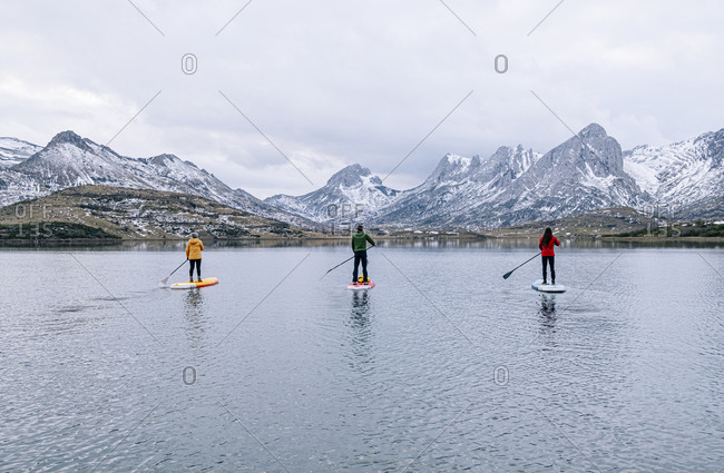 Three people stand up paddle surfing- Leon- Spain