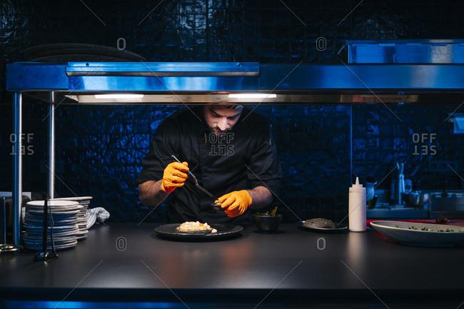 Chef preparing a dish in restaurant kitchen