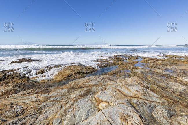 New Zealand- Rocky coastal beach of Pacific Ocean