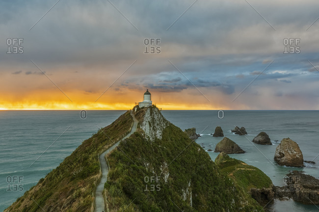 New Zealand- Oceania- South Island- Southland- Otago- Southern Scenic Road- Cape Nugget Point- Nugget Point Lighthouse at sunrise