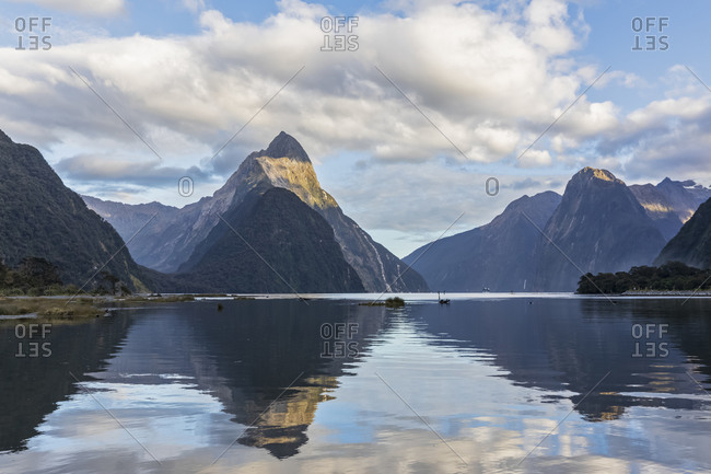 New Zealand- Scenic view of mountains reflecting on shiny surface of Milford Sound