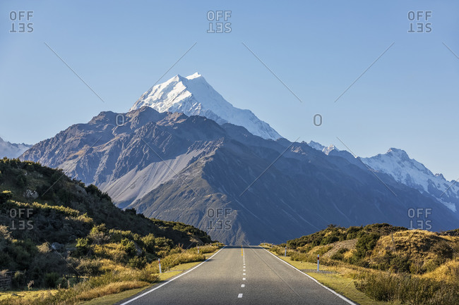 New Zealand- Oceania- South Island- Canterbury- Ben Ohau- Southern Alps (New Zealand Alps)- Mount Cook National Park- Mount Cook Road and Aoraki / Mount Cook- Empty road in mountain landscape