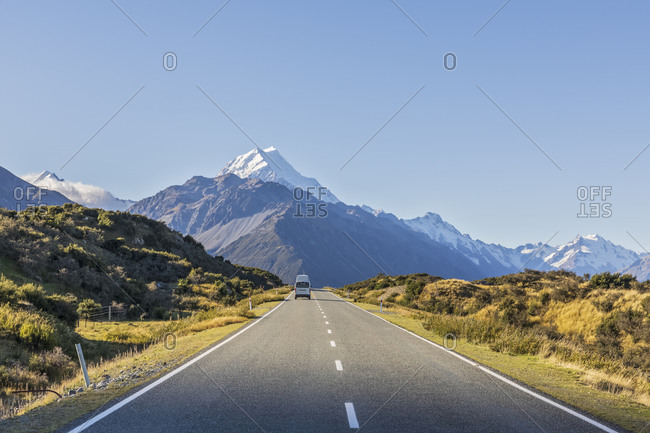 New Zealand- Oceania- South Island- Canterbury- Ben Ohau- Southern Alps (New Zealand Alps)- Mount Cook National Park- Mount Cook Road and Aoraki / Mount Cook- Camper on road in mountain landscape