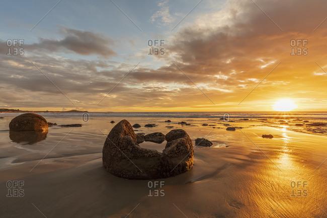 New Zealand- Oceania- South Island- Southland- Hampden- Otago- Moeraki- Koekohe Beach- Moeraki Boulders Beach- Moeraki Boulders- Round stones on beach at sunrise