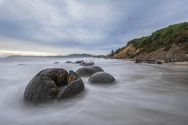 New Zealand- Oceania- South Island- Southland- Hampden- Otago- Moeraki- Koekohe Beach- Moeraki Boulders Beach- Moeraki Boulders- Round stones on beach