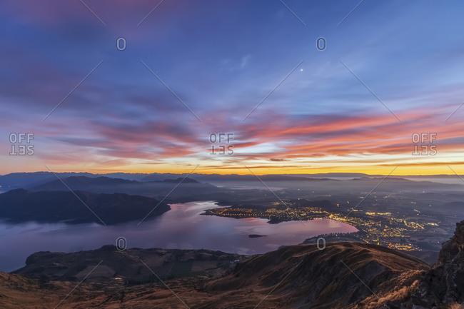 Lake Wanaka and Wanaka City during sunrise- view from Roys Peak- South Island- New Zealand