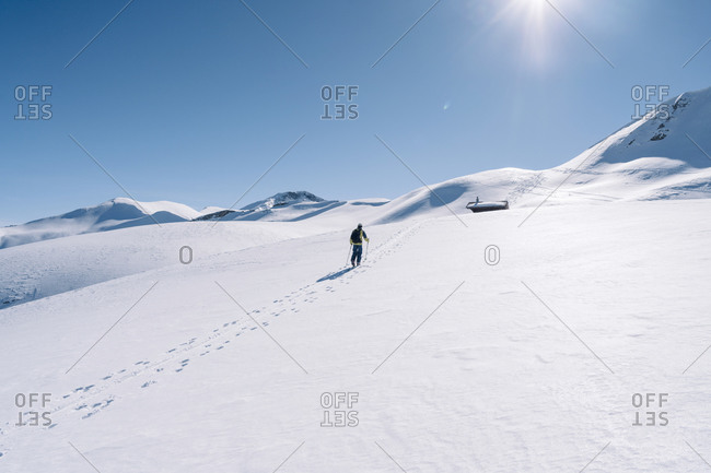 Man in backlight on ski tour- Grisons- Switzerland