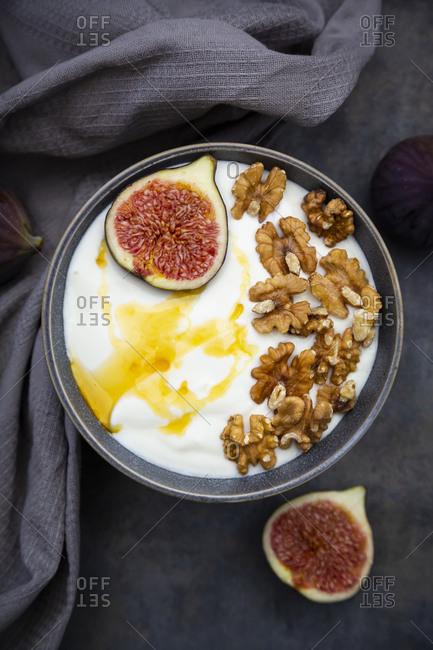 Bowl of Greek yogurt with honey- walnuts and sliced fig