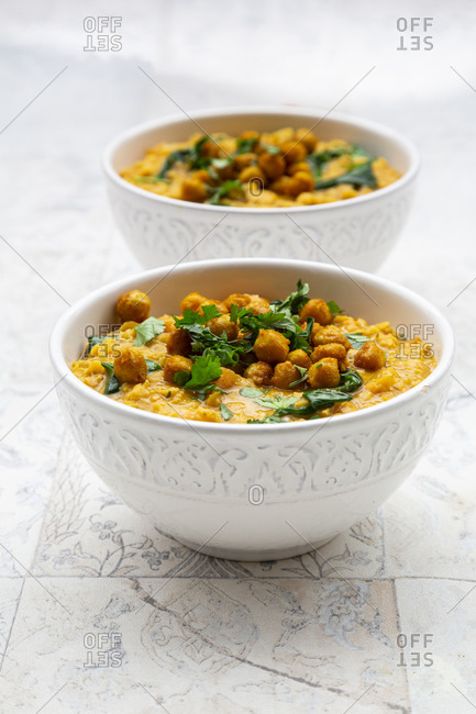Vegan lentil curry with red lentils- sweet potatoes- spinach- roasted turmeric- chickpeas- with lime juice and coriander