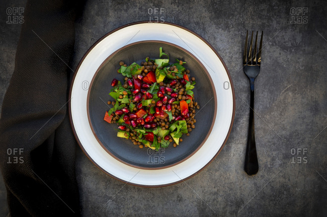 Oriental lentil salad with lentils- cucumber- bell pepper- parsley and pomegranate seeds