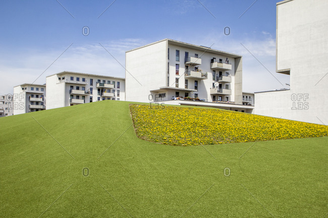 Germany- Bavaria- Munich- Green lawn in front of residential buildings in Theresienpark