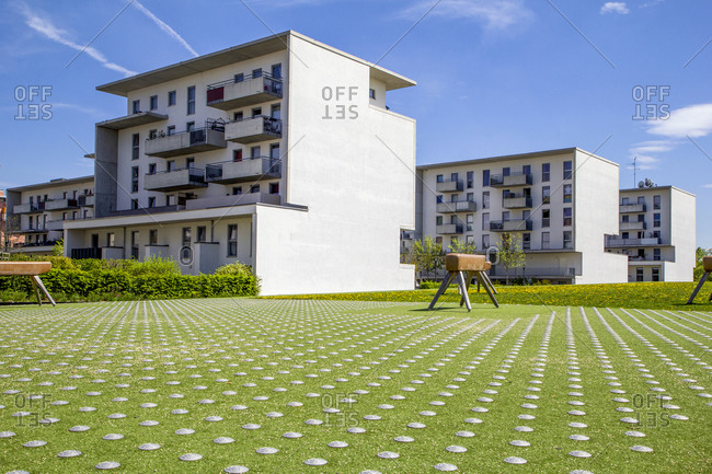 Germany- Bavaria- Munich- Playground with gymnastics vaults in front of residential buildings in Theresienpark