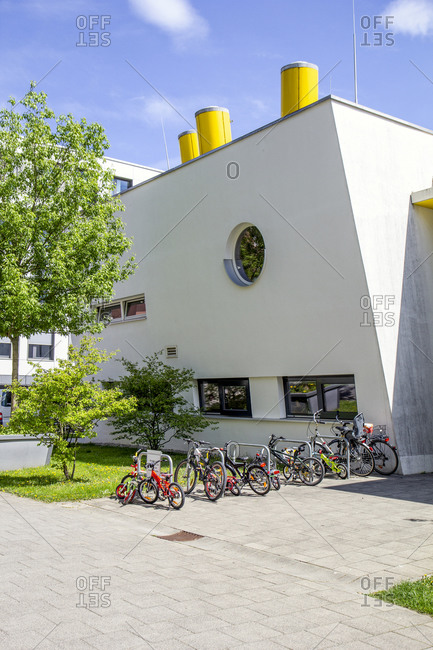 Germany- Bavaria- Munich- Bicycles parked in front of modern preschool in Theresienpark