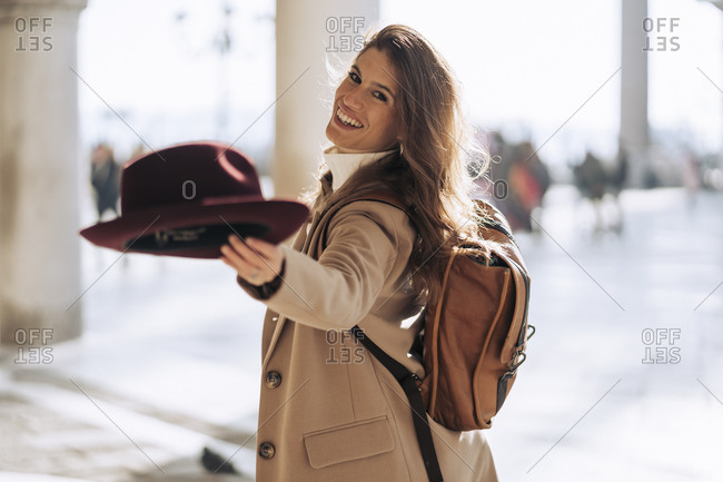 Portrait of happy young woman visiting the city of Venice- Italy