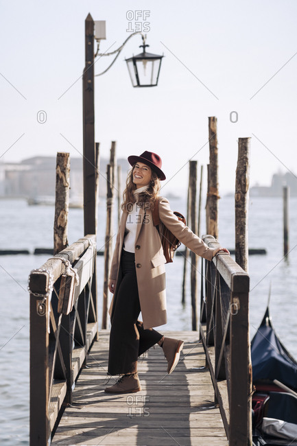 Happy young woman at the waterfront in Venice- Italy