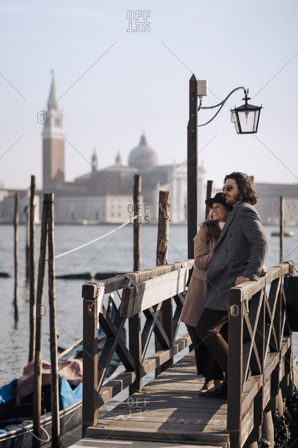 Young couple at the waterfront in Venice- Italy
