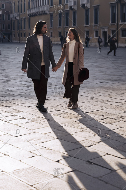 Young couple visiting the city of Venice- Italy