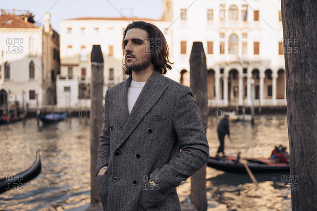 Young man at the Canal Grande in Venice- Italy