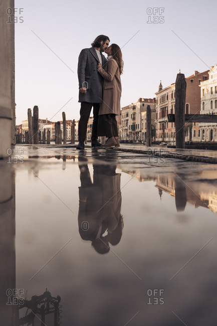 Affectionate young couple kissing in the city of Venice- Italy
