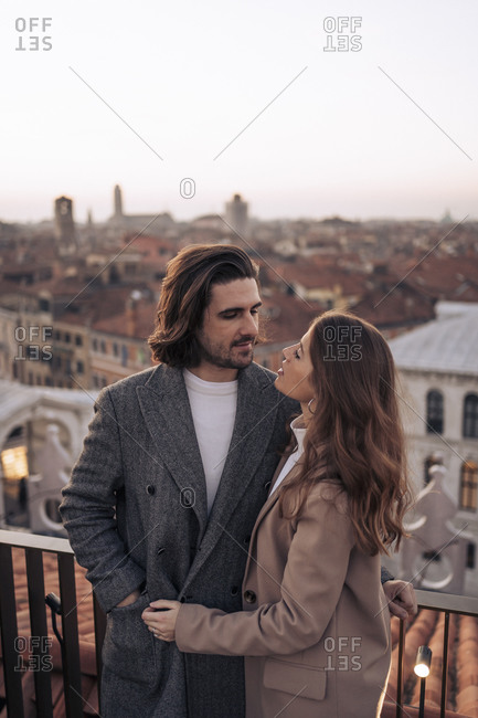 Affectionate young couple on a balcony above the city of Venice- Italy