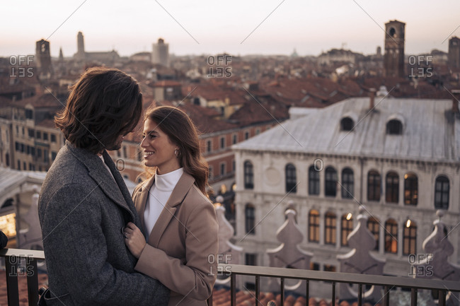 Happy young couple on a balcony above the city of Venice- Italy